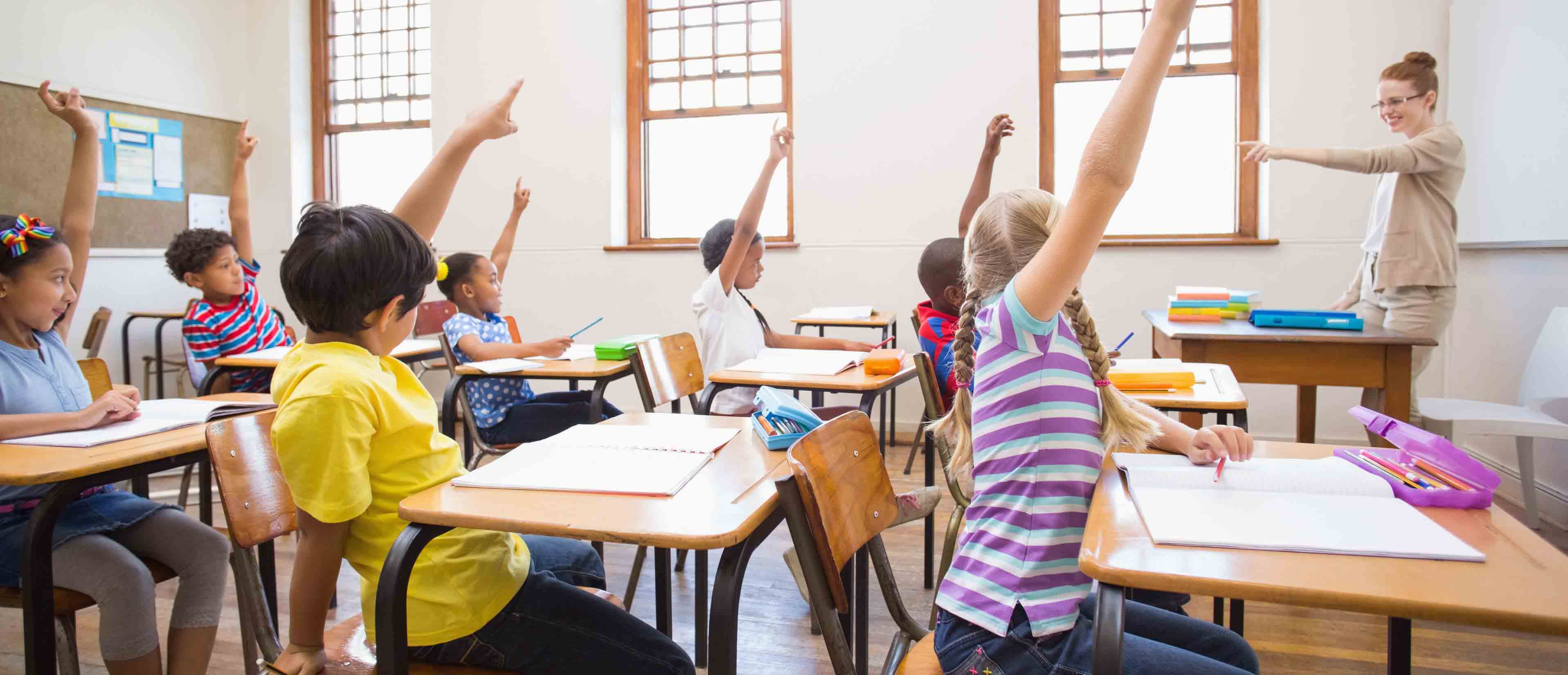 kids raising hands to answer kids math questions